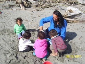 Vanessa and the children in her care explore Waiotahe Beach together.